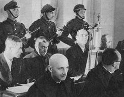 Ludwig Fisher (second row, first from the left) during his trial before the Supreme National Tribunal in Warsaw.