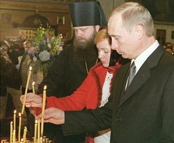 Putin and wife Lyudmila in New York at a service for victims of the September 11 attacks, 16 November 2001