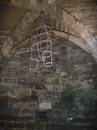A gibbet, previously on display in the dungeon in the basement of Caesar's Tower