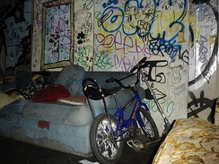 The graffiti-covered backstage area at the Gilman Street venue.