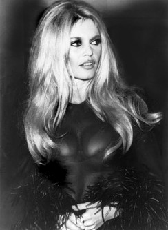 French actress Brigitte Bardot wearing a transparent top and a feather boa, 1968