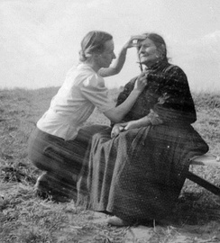 "Eva Justin checking the facial characteristics of a Romani woman, as part of her ""racial studies"""
