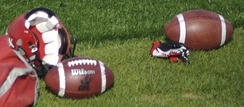 Footballs and a helmet at a Calgary Stampeders (CFL) team practice