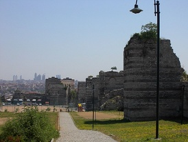 The section of the Theodosian Walls that adjoins the walls of Blachernae, with the Palace of the Porphyrogenitus in the background, as they appear today in suburban Istanbul.