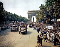 The Free French 2nd Armored Division marches down the Champs-Élysées on 26 August 1944 to celebrate the Liberation of Paris.