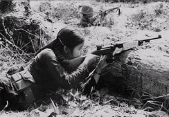 Female Viet Cong guerrilla in combat