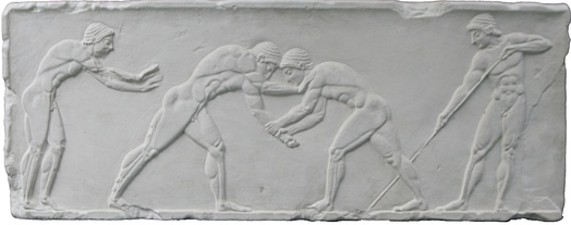 Wrestlers take centre stage on an Ancient Greek relief of the pentathlon, 500 BC. To the left is a sprinter in the starting position, and to the right is a javelin thrower adjusting his grip.