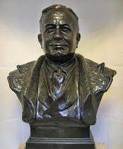 A bronze bust of Herbert Chapman stands inside Emirates Stadium