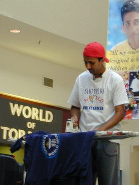 Suresh Joachim Arulanantham is a Tamil Canadian film actor and producer and multiple-Guinness World Record holder who has broken over 50 world records set in several countries in attempts to benefit the underprivileged children around the world. Some world record attempts are more unusual than others: he is pictured here minutes away from breaking the ironing world record at 2 days, 7 hours and 5 minutes, at Shoppers World, Brampton.