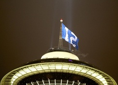 12th man flag flying on the Space Needle the day of the game