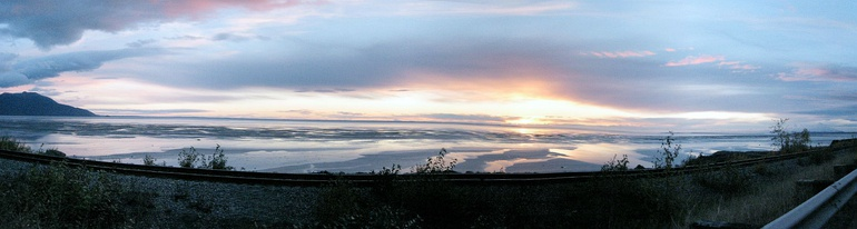 "Panorama of Cook Inlet near the mouth of Turnagain Arm, a few miles south of the ""Anchorage bowl."" The tide is out, exposing the surrounding mudflats."