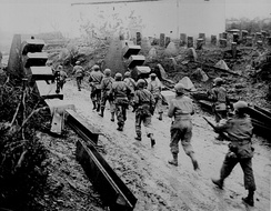American troops cross the Siegfried Line into Germany.