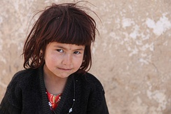 A young Afghan girl in Qalat pictured by the 116th Infantry Battalion before receiving school supplies in 2011