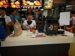 A McDonald's employee takes an order in the Philippines