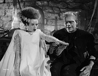 Elsa Lanchester played the Monster's Bride in Bride of Frankenstein. Her conical hairdo and white lightning-trace steaks on each side, has become an iconic symbol of the character.