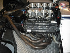 Cosworth DFV engine mounted in BT49C. The curved underside of the car can be seen beneath it.