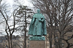 Statue of Archbishop Hughes gifted in 1891, Rose Hill campus[222]