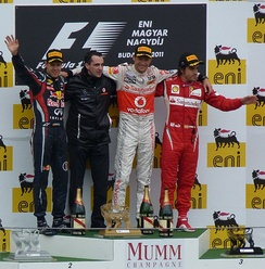 Jenson Button, race winner in his 200th Grand Prix start, is accompanied by Vettel (second), Alonso (third) and his engineer Dave Robson on the podium at the Hungarian Grand Prix
