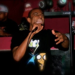 MC Hero performing rhythmic rhyming known as rapping in Huntsville, Alabama.