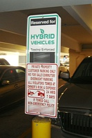 Some shopping malls in Northern Virginia have designated reserved parking spaces for electric hybrid cars.