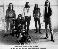 Joplin (seated) with Big Brother and the Holding Company, c. 1966–1967 photograph Bob Seidemann