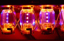 "The glow from four KT88 model ""Electro Harmonix"" brand power tubes lights up the inside of a Traynor YBA-200 guitar amplifier"