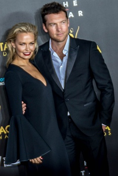 Lara Bingle and Worthington on the 2014 AACTA Awards red carpet