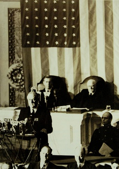 President Roosevelt delivers the Infamy Speech to Congress. Behind him are Vice President Henry A. Wallace (left) and Speaker Sam Rayburn.