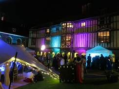 Cloister Court lit up during the 2013 Queens' May Ball