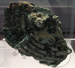 This is the Antikythera mechanism, which is considered the first mechanical analog computer, dating back to the first century.