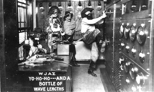 "In 1926 WJAZ in Chicago, Illinois challenged the U.S. government's authority to specify operating frequencies and was charged with being a ""wave pirate"". The station responded with this February 1926 publicity photograph of its engineering staff dressed as ""wave pirates"".[5]"