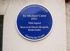A blue plaque erected in 2003 marks Caine's birthplace at St Olave's Hospital.