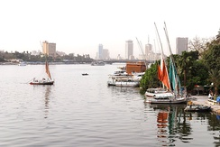 The river Nile flows through Cairo, here contrasting ancient customs of daily life with the modern city of today