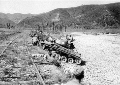 M24 Chaffee light tanks of the US Army's 25th Infantry Division wait for an assault of North Korean T-34-85 tanks at Masan