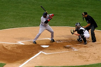 David Ortiz (in gray) of the Boston Red Sox stands in the left-handed hitters' batter's box at U.S. Cellular Field against the Chicago White Sox on July 7, 2006.