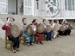 North Korean children performing for tourists at Chonsam Cooperative Farm near Wonsan