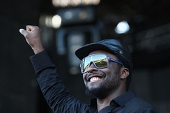 will.i.am performing with The Black Eyed Peas in June 2009