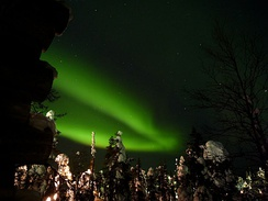 One of the main attractions of northern Lapland in terms of tourism is the opportunity to locate bright Aurora Borealis from the sky.[21] The picture was taken from Ruka, Finland in 2011.