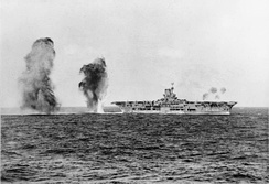 British aircraft carrier HMS Ark Royal under attack from Italian aircraft during the Battle of Cape Spartivento (Nov. 27, 1940)