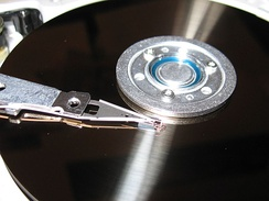 Hard disk drives record data on a thin magnetic coating