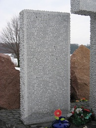 One of the stone tablets of the monument which lists the names of Poles killed at Huta Pieniacka.