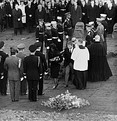 Jacqueline Kennedy and Attorney General Robert F. Kennedy walk away from President Kennedy's casket during interment at Arlington National Cemetery on November 25, 1963.