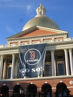 The Massachusetts State House displaying a banner in honor of the Red Sox's 2013 World Series appearance