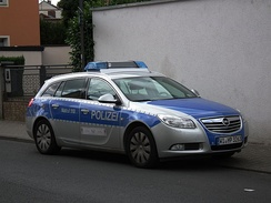 An Opel patrol car of the Hesse State Police wearing the silver/blue livery (including the reflective strips)
