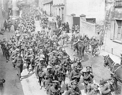 French and British troops marching back through Passy-sur-Marne, 29 May 1918.