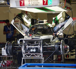 Toyota TS050 Hybrid No. 7 in garage, showing the front suspension