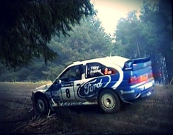Bruno Thiry cuts a corner on the 1998 Network Q Rally in his Ford Escort WRC