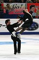 Male ice dancer in Besti squat while lifting partner
