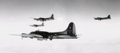 B-17Gs of the 398th Bomb Group over a target.