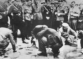 March or April 1938: Jews are forced to scrub the pavement in Vienna.